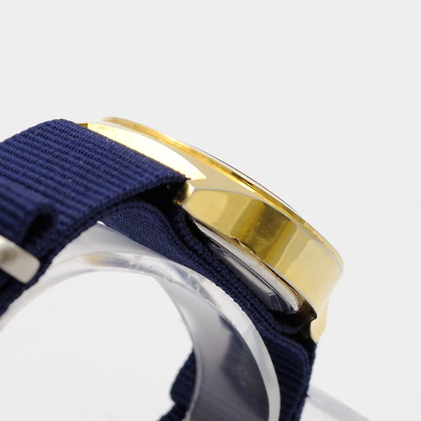złocona koperta zegarka