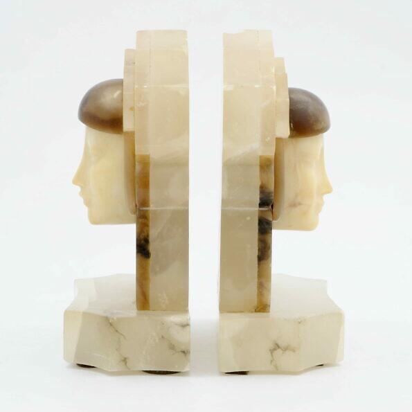 Podpórki do książek w formie kobiecych głów art deco