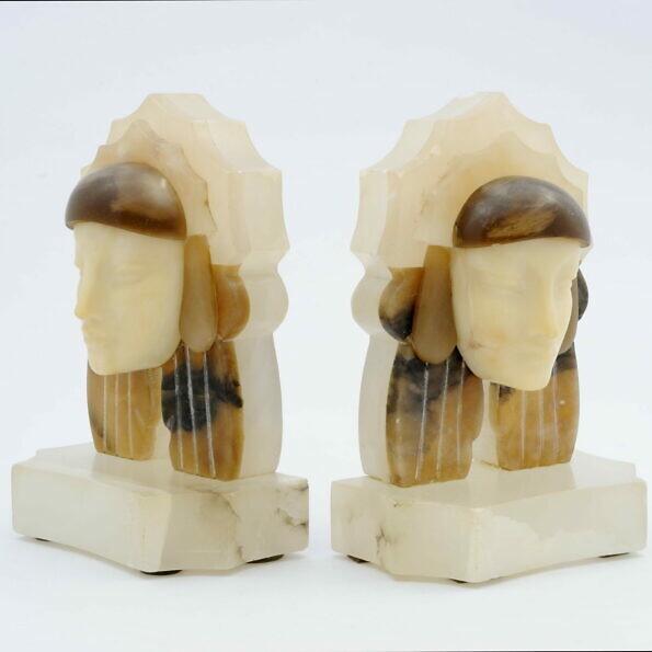 Podpórki do książek z lat 30. art deco w formie kobiecych głów